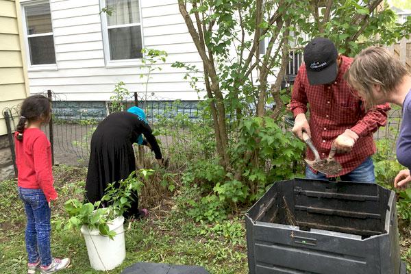 Syrian-refugee-family-working-in-NDSC-garden-3