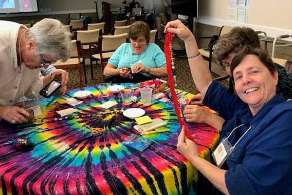 Charity-Moving-Forward-2017-gathering beading